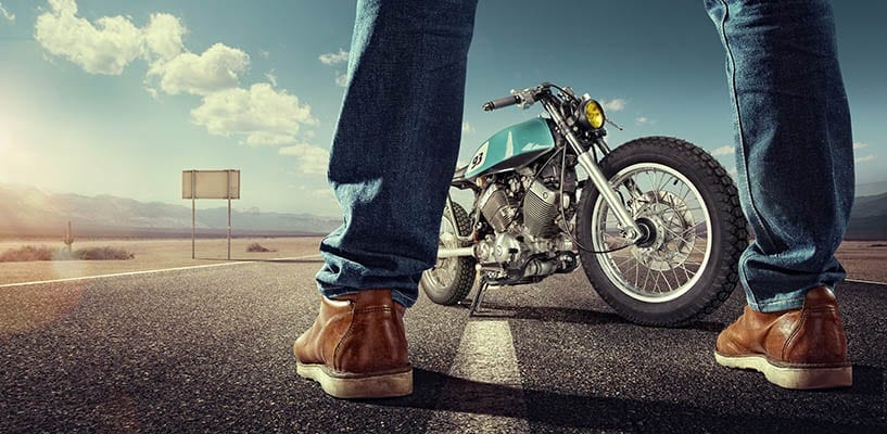 photo: rider by his motorcycle