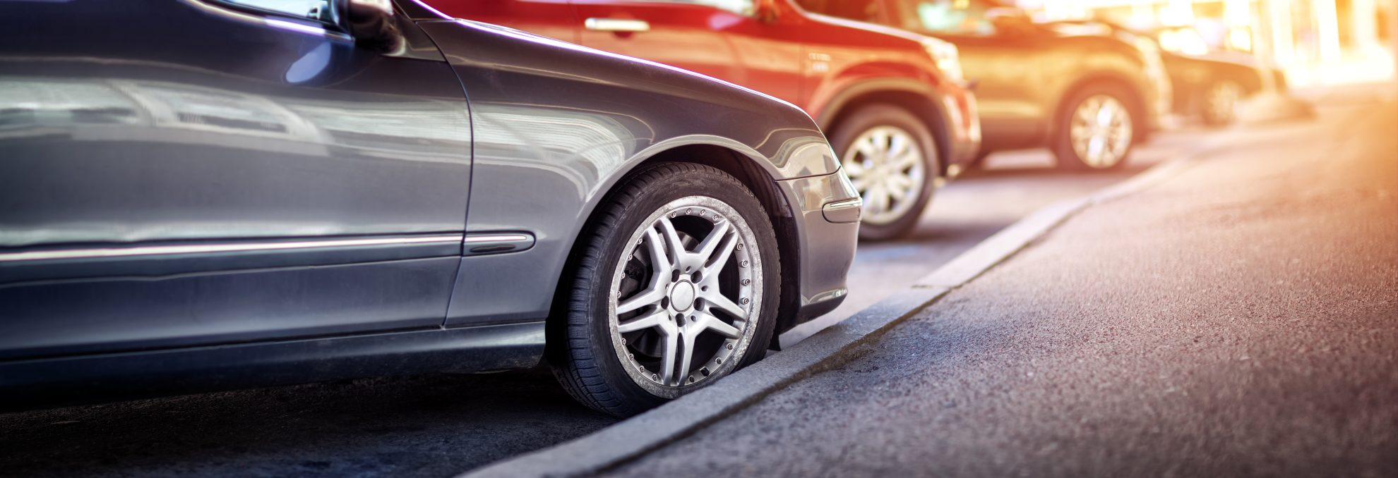 cars lined up on curb for extended warranty