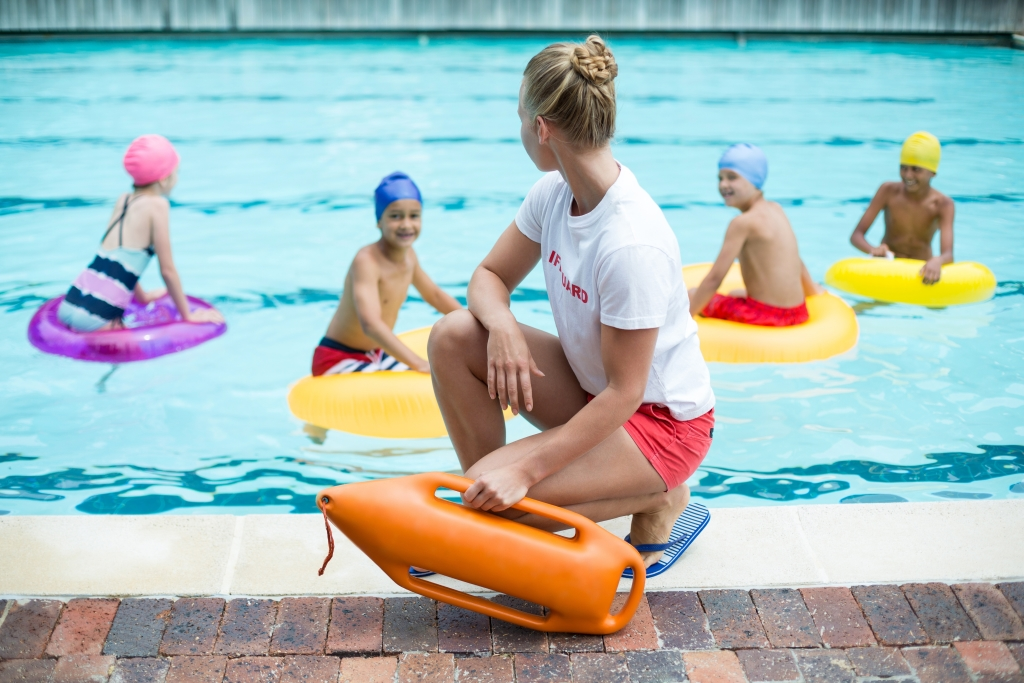 lifeguard overseeing children swimming