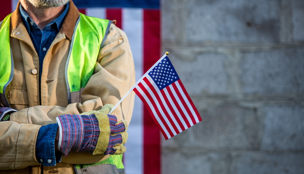Firefighter holding an american flag