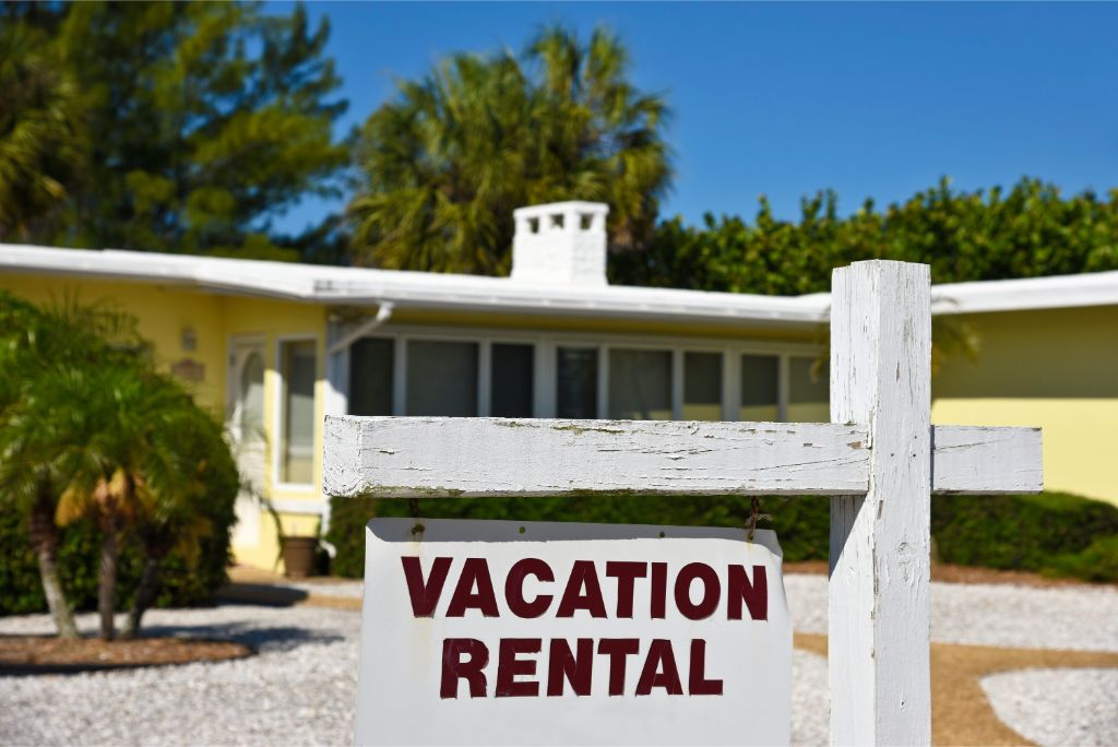Rental sign in front of vacation home